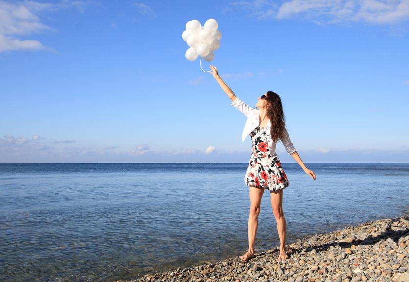Happy young woman enjoying summer vacation